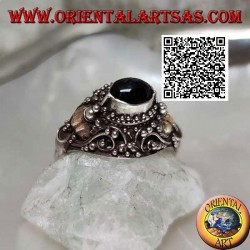 Silver ring with a raised horizontal oval onyx on ethnic setting with 14 carat gold leaves