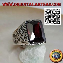 Silver ring with faceted rectangular garnet and geometric labyrinth engraved on the sides