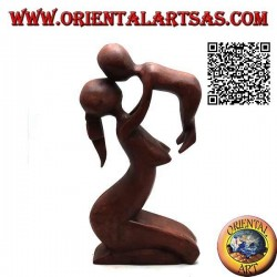 Sculpture of a mother who lifts to the sky and kisses her child in 20 cm suar wood