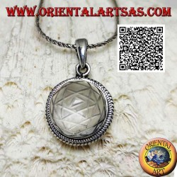 Silver pendant with Sri Yantra engraved on round cabochon rock crystal surrounded by double weaving