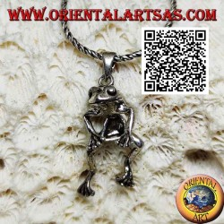 Silver pendant in the shape of a frog jointed on the center