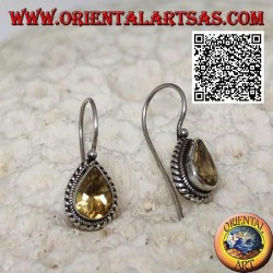 Silver earrings with natural teardrop yellow topaz surrounded by weaving
