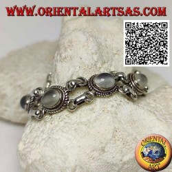 Double chain silver bracelet with 5 cabochon oval moonstones surrounded by interweaving