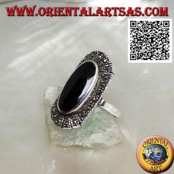 Silver ring with raised elongated oval onyx surrounded by marcasite
