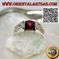 Silver ring with square faceted garnet and openwork floral decoration on the sides