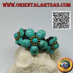 Soft bracelet with five turquoise paste flowers and golden brass balls