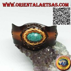 Adjustable rigid bracelet with central oval turquoise and two-color leather processing