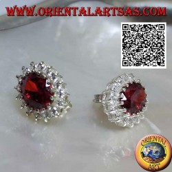 Silver lobe earrings with oval faceted garnet surrounded by white zircons