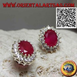 Silver lobe earrings with oval ruby surrounded by white zircons