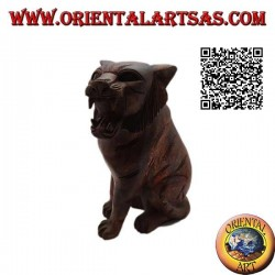Sculpture of a seated tiger hand carved from a single 20 cm block of suar wood