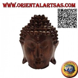 Three-dimensional Buddha head sculpture carved from a single 12 cm block of suar wood