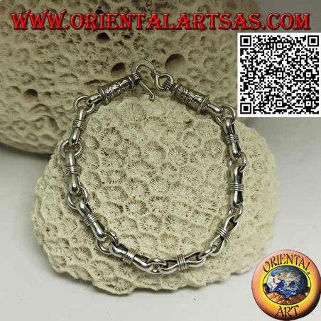 Soft silver chain bracelet with alternating rings and narrow ovals in the center and engraved clasp