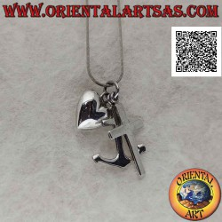 Smooth silver pendant, the...