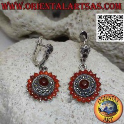 Round silver earrings with...