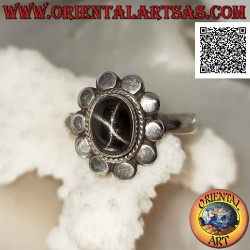 Silver ring with black star...