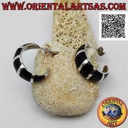 Silver earrings from lobe...