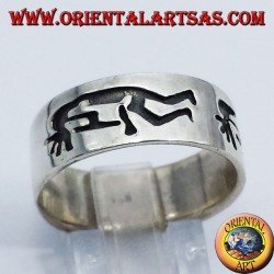 Ring in silver band kokopelli