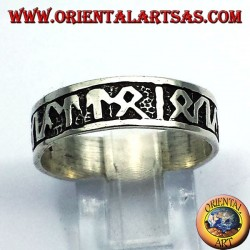 silver ring with Celtic runes