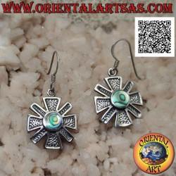 Silver earrings in the...