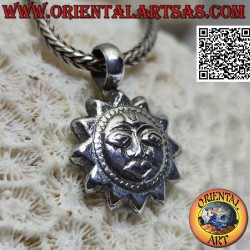 Silver pendant, sun with...