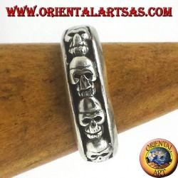 banda de anillo de plata, cráneos