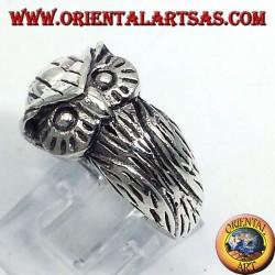 silver ring, enveloping Owl