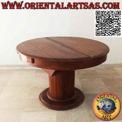 Round extendable table on a...