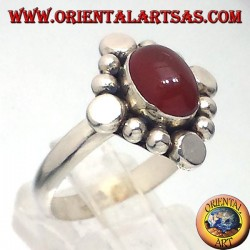 Silver ring with carnelian oval cabochon