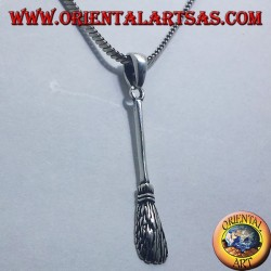 silver pendant, flying broom