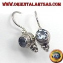 Silver earrings with blue topaz faceted round