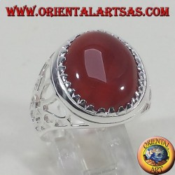 Silver ring carved with oval carnelian