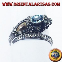 Silver ring cobra with 14 carat gold plate and blue topaz