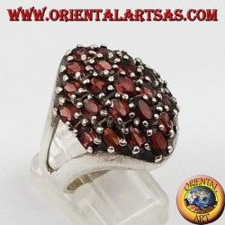 Silver ring with faceted oval natural garnets