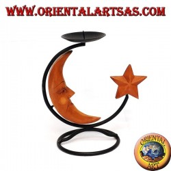 Iron candlestick with moon and star in wood