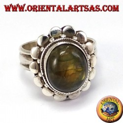 Silver ring with studded border with oval labradorite