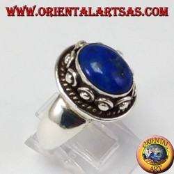 Silver ring with studSilver ring with studs around the box, with oval natural lapis lazuli