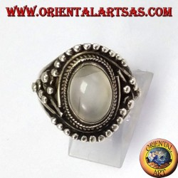 Silver ring with oval stone (adularia) oval with asymmetrical ball decorations