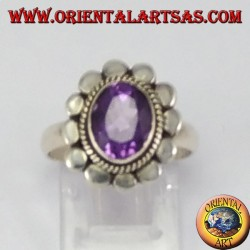 Silver ring with oval faceted natural amethyst with studded rim