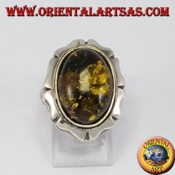 Silver ring with large green oval amber