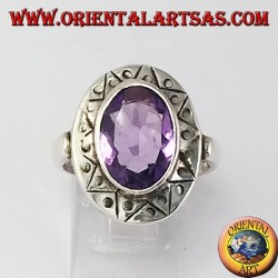 Silver ring with oval faceted natural amethyst with chiselled rim