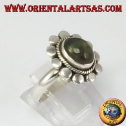 Silver ring with oval labradorite and studded border