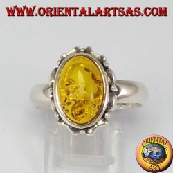 Silver ring with oval amber on carved edge
